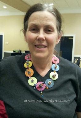 Deb models Roz's necklace