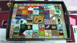 Tray with tiles attendees made. Auctioned and proceeds donated to http://plancanada.ca/because-i-am-a-girl